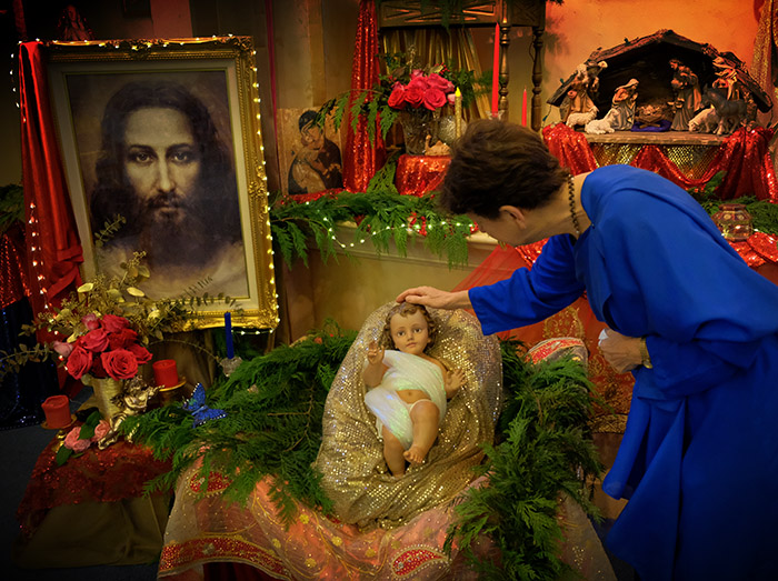 """Nayaswami Asha: """"Good morning, Baby Jesus!"""" Photo taken at Ananda Sangha in Palo Alto, California."""